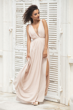 Elegant beautiful african american woman posing in maxi dress outdoor. Stock Photo
