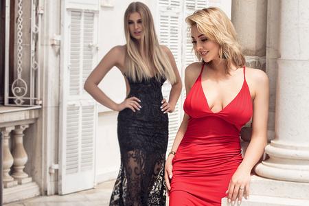 Two elegant blonde caucasian women posing.