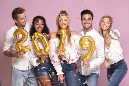 Group of beautiful young people celebrating new year 2019.