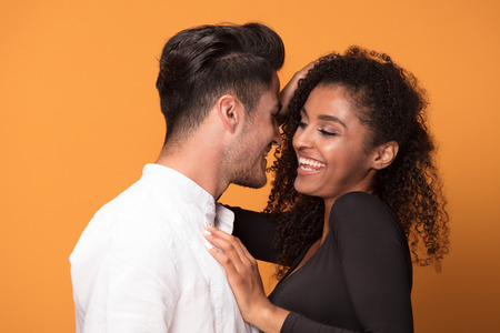 Happy beautiful mixed race couple. Smiling african american girl with handsome man posign together.