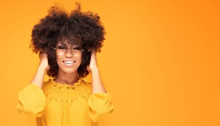 Happy african american woman smiling. Young emotional afro woman. The human emotions, facial expression concept.