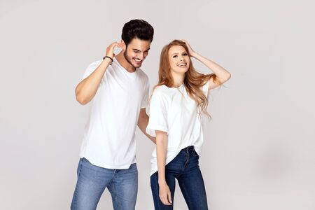 Beautiful young happy couple isolated on studio background. Facial expression, human emotions, advertising concept. Man and woman posing together.Love and friendship. Stock Photo