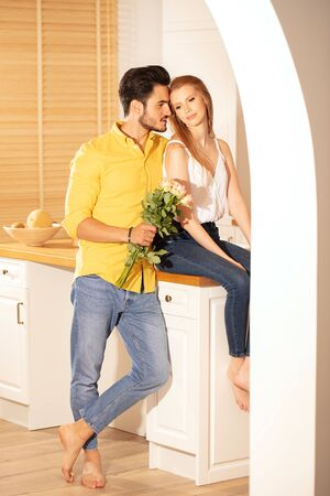 Romantic date. Handsome man giving flower bouquet to beautiful woman. True feelings. Human emotions and expression concept.