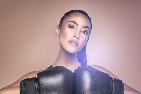 Female fighter. Sexy woman in boxing gloves. Sportswoman. Sport, boxing and fitness concept.