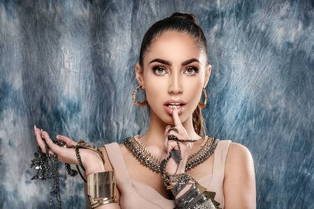 Beautiful woman with a lot of jewelry . Beauty and accessories.