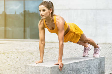 Positive caucasian woman in sportswear workout, outdoor sport. Healthy lifestyle concept.