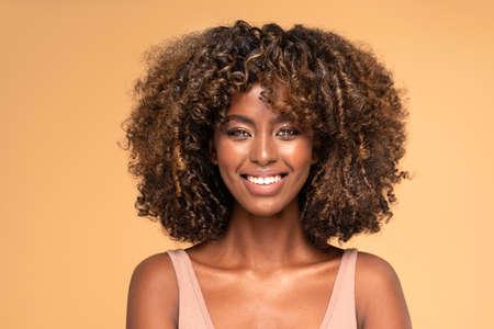 Happy african american woman smiling. Beauty female portrait.