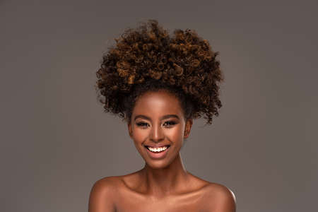 Beauty portrait of woman with afro posing in studio.