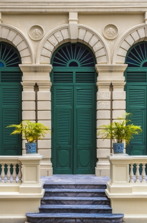 European style green door of old building in Grand Palace ,Bangkok Thailand  This photo is taken at the tourist s exit of Grand Palace  Stock Photo