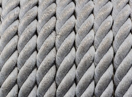 Old nautical rope, close-up as nautical background and texture