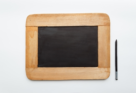 Old vintage  wooden frame blank slate and pencil isolated on white background