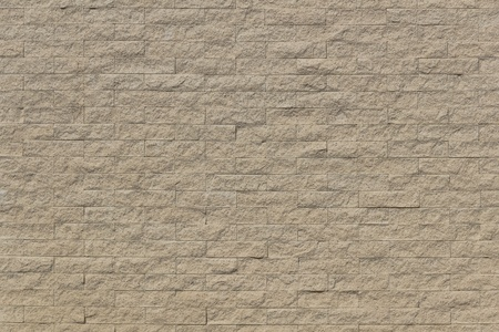 The wall was constructed by sand stone materials  Sand stone bricks pattern was shot on suuny day  photo