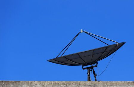 Satellite Dish with Blue Sky on Roof, Closeup photo