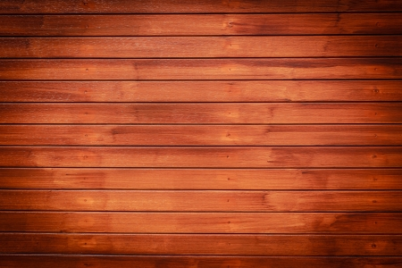 Wood texture background in horizontal pattern, dark brown color  photo