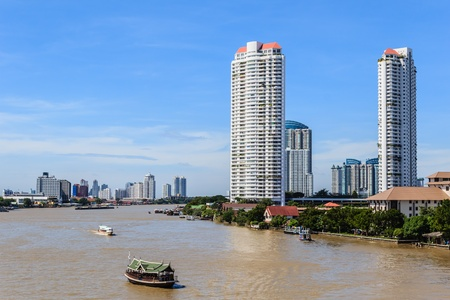 The riverside skyscraper buildings against the skyline in Bangkok, Thailand  photo