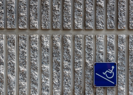 ramp: Ramp access sign for the disabled on concrete wall background