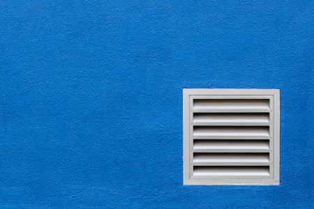 White Vent on Blue Concrete Wall photo