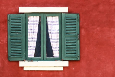 Old Green Window with Curtain on Red Wall,  Copy Space on Right Stock Photo - 20184752