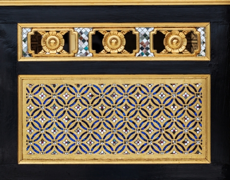 Wood Carving Traditional Thai Style in gold Color with Stained Glass Decoration on Black Background