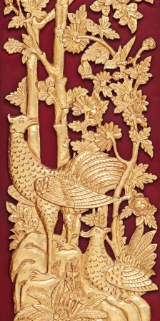 Mythical Thai Style Carving on red Wooden Wall, General Thai Temple Art photo