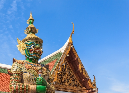Green Demon  Guardian Statue against Blue sky Background in Thai Temple, Bangkok, Thailand Stock Photo