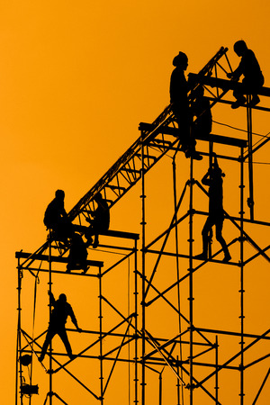 Silhouette of Workmen on assembling concert stage photo