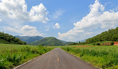 Road View to Mountains in Sunshine Day photo