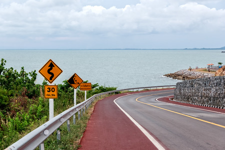 Winding Road with several Warning Traffic Signs photo