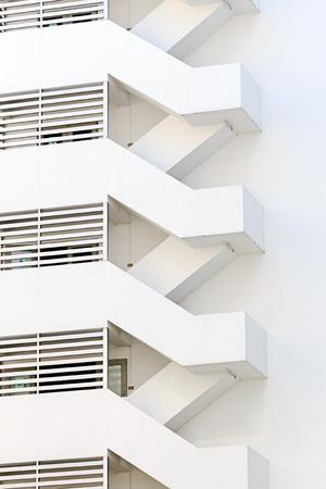 escape: Fire Escape outside White Building