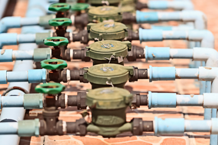 Rusted Water Valves and Old Water meters, Focus on center photo