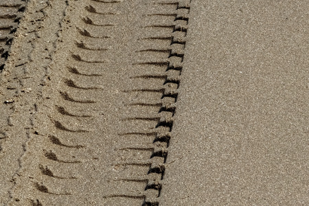 Wheel Track on Sand, Closeup Stock Photo