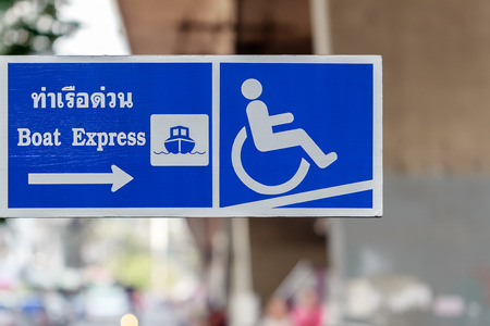 Boat Express Pier signboard showing Ramp Access Facilities for the Disabled, Bangkok,Thailand.