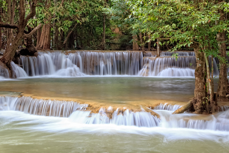 Rainforest Waterfall in Kanchanaburi Province, Thailand photo