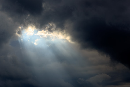 Sun beam in Dark Clouds and Sky before Thunderstorm photo