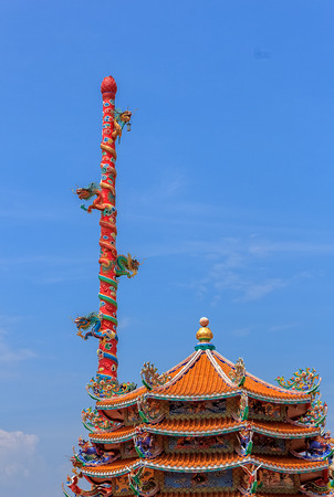 Traditional Chinese Shrine against Blue Sky Background photo