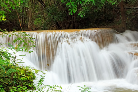 Deep Forest Waterfall in Kanchanaburi Province, Thailand photo
