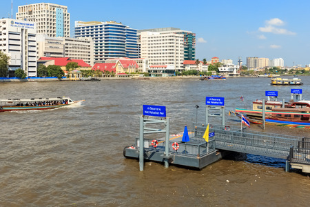 BANGKOK - JANUARY 9 : Boat piers in Chao Phraya River for tourists and general passengers near The Royal Grand Palace on January 9, 2015 in Bangkok, Thailand.