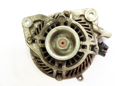 Dirty and Old Automotive alternator, Closeup on white background Stock Photo
