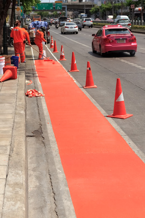 Bike Lane Renovation in Bangkok, Thailand, with Workers in Background Editorial