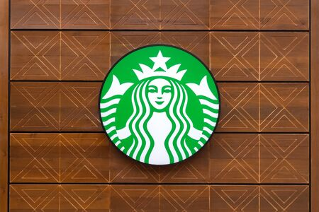 BANGKOK - JULY 19: Starbucks sign is displayed at the facade of a Starbucks store, on July 19, 2015 in Bangkok, Thailand. Starbucks is the worlds largest coffee house which has more than 22,000 stores in 66 countries.