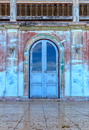 Weathered Blue Arch Door to Old Building