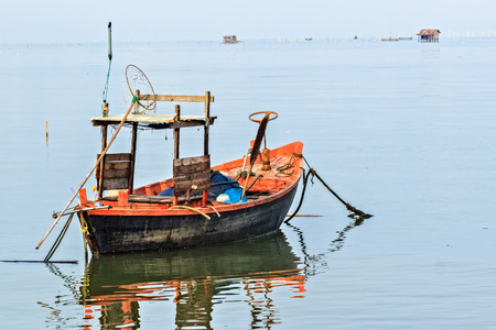 Old Fisherman Boat Small with Traditional Fishing Tools, Thailand Stock Photo