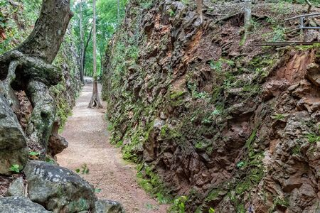 hellfire: Hellfire Pass at Kanchanaburi, Thailand. The steep rock wall was cut through by the World War II Prisoners hand.