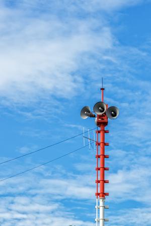 Loudspeaker Tower against Blue Sky Background
