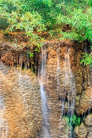 Small Waterfall in Forest under sunlight, Thailand
