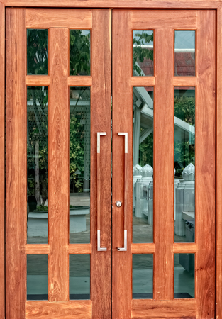 Double Wooden Doors with mirror reflection Stock Photo