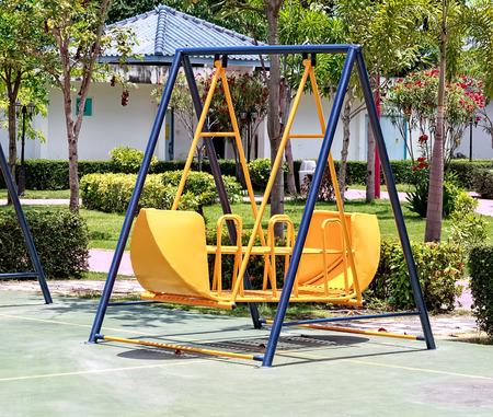 Yellow Swing in Children Playground