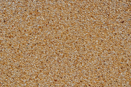 Fine Gravel Texture on Brown Concrete Wall in sunny day, Close up Texture and Background in Natural color, Stock Photo