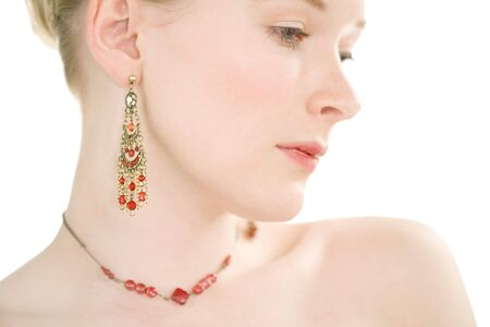 Close up face shot of pale skinned model with red jewellery Stock Photo - 688459