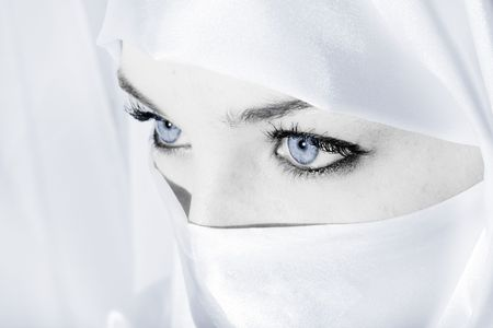 covered: Woman in white face veil Stock Photo